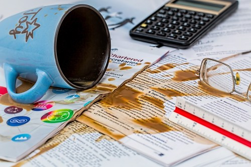 coffee spilled onto work station employee mistakes