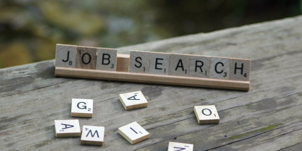 "scrabble letters that spell ""job search"""