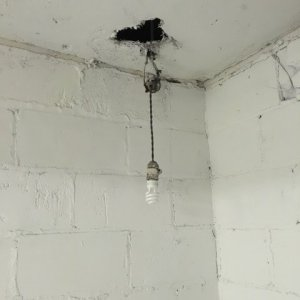 An improperly installed light found during a home inspection in Canton.