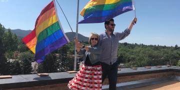Gov. Lujan Grisham and Speaker Egolf hoist Pride flags atop the Capitol in Santa Fe