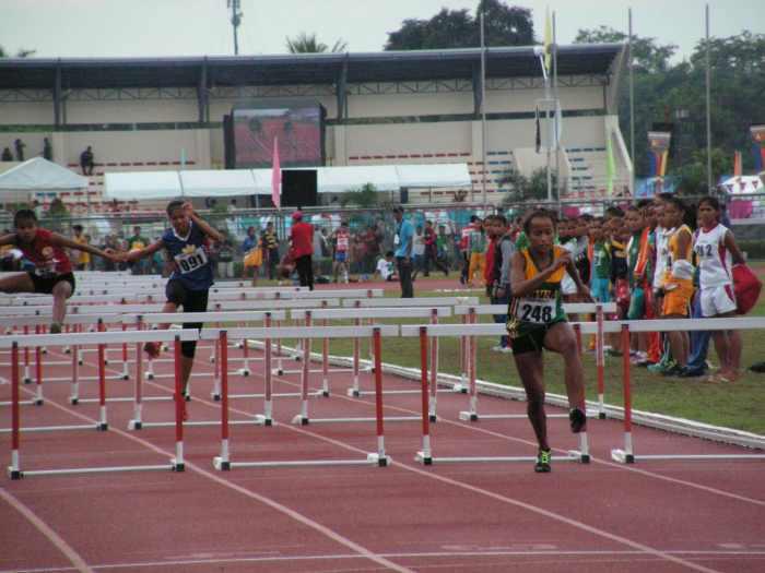 Karen Janario leading the pack in the 100m Hurdles heats.