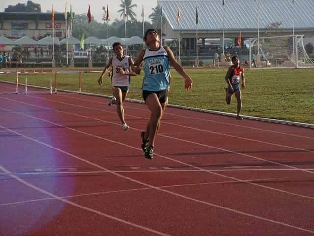 Alexis Soqueno throws his head back in triumph after winning the boys 400 Hurdle title at 2015 Palarong Pambansa in Tagum. Photo Credit: Copyright Airnel T. Abarra of pinoyathletics.info