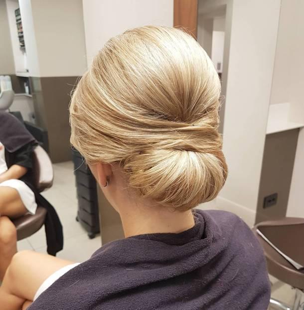 Fancy with style weddinghair bun updo chignon urbanfrizerskisaloni