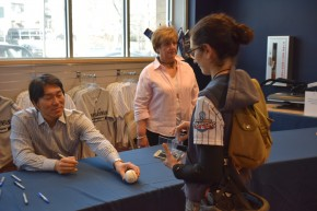 A fan gets her ball signed by Matsui in the Team Store