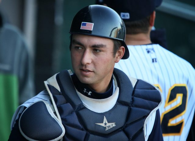 Trenton Thunder catcher Kyle Higashioka in the dugout before a game against the Portland Sea Dogs at ARM & HAMMER Park in Trenton on Wednesday, April 13, 2016. Photo by Martin Griff