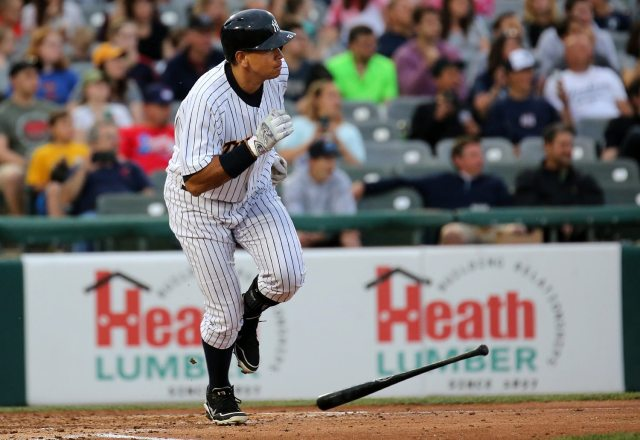 New York Yankees slugger Alex Rodriguez singles on a ground ball to center field in the third inning, scoring Cito Culver for the Trenton Thunder's first run at ARM & HAMMER Park in Trenton on Tuesday, May 24, 2016 against the New Hampshire FisherCats. Rodriguez joined the Double A team as part of a rehab assignment because of a hamstring injury Photo by Martin Griff