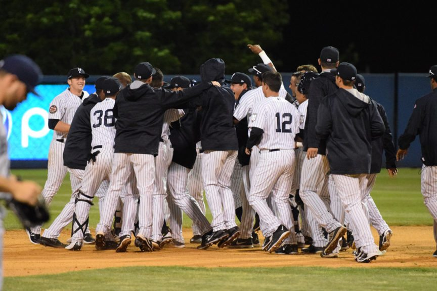 The Staten Island Yankees celebrate their victory over the Brooklyn Cyclones in extra innings. (Robert M. Pimpsner/RMP Sports Media, Inc.)