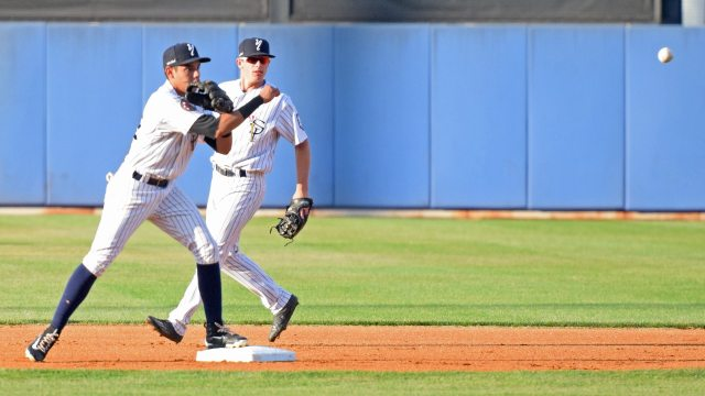 Staten Island Yankees shortstop Danienger Perez turns a double play in the top of the first inning. (Robert M. Pimpsner)