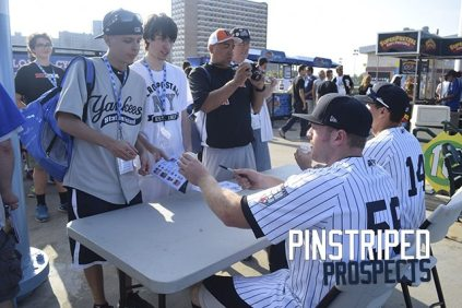 Connor Spencer and Ty McFarland sign for Yankees fans on the MCU Concourse