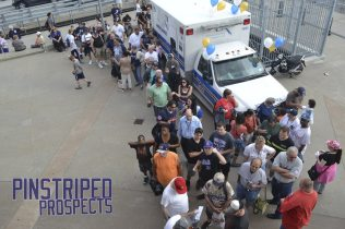 Fans lined up at the front gate prior to the stadium opening (Robert M. Pimpsner)