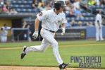 Staten Island Yankees OF Jeff Hendrix races down the first base line (Robert M. Pimpsner)