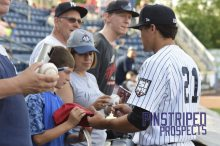 Staten Island Yankees infielder Ty McFarland signs autographs for fans before the game (Robert M. Pimpsner)