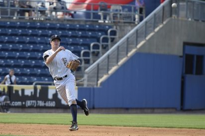 Kyle Holder throws the ball to first to make the final out of the fourth inning (Robert M Pimpsner)