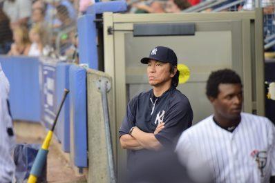 Hideki Matsui watches intently in the Staten Island Yankees dugout (Robert M Pimpsner)