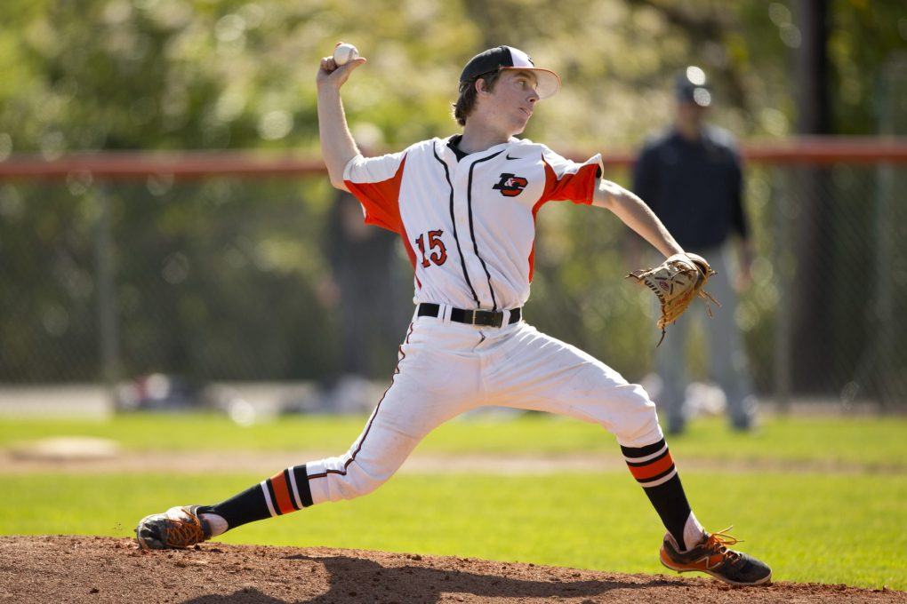 Bradley Bourdase '19 winds up on the mound. (Photo Courtesy LC Pioneers)