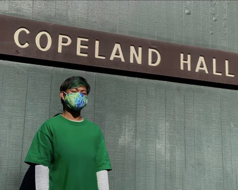 Ezri Rayes in front of Copeland Hall sign