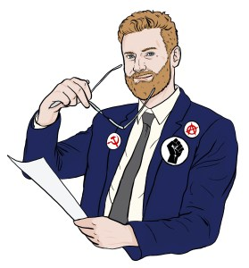 Bearded white guy wearing a navy suit with various pins of support for social movements