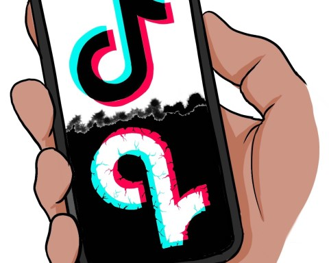A cell phone screen shows a mirrored TikTok logo, one side bright and normal, the other dark and dilapidated