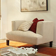 A plush fabric chair in a square shape is comfy and calming.