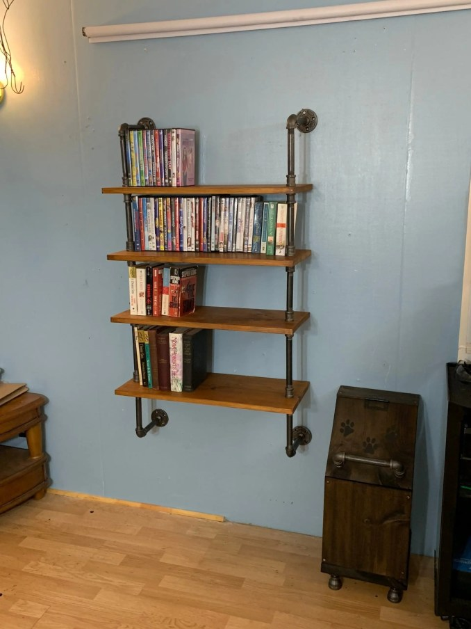 https://i0.wp.com/pipeworkpieces.com/wp-content/uploads/2021/01/4-tier-wall-mounted-dvd-book-rack-wall-rack-for-dvd-book-case-book-shelf-5ff78aae-scaled.jpg?w=678&ssl=1