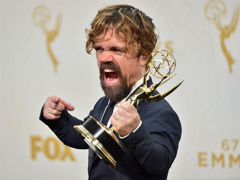 Peter Dinklage holding a wine glass
