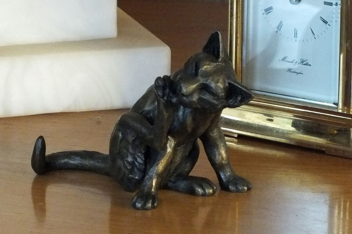 bronze resin Cat Sitting Licking One Paw