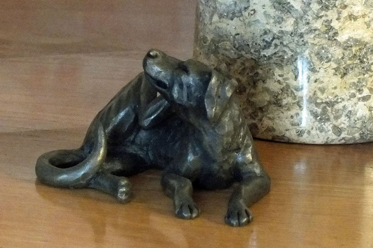 bronze resin Dog Lying Scratching
