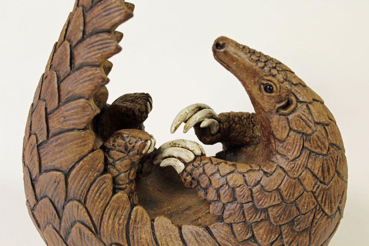 Curled up Pangolin - ceramic clay sculpture