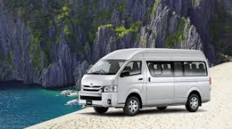 A modern mini van used to transfer tourists to Coron