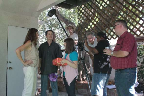 Cast and crew of Rage of Innocence, director Pirro looking maniacal behind the camera