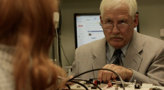 Ken Briant looking pretty darn official as the polygraph technician