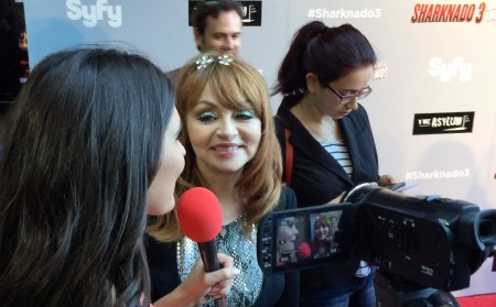 Interviewer filming comedian Judy Tenuta at Sharknado red carpet