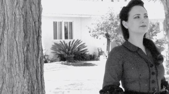 Actress Lauren Baldwin in black and white