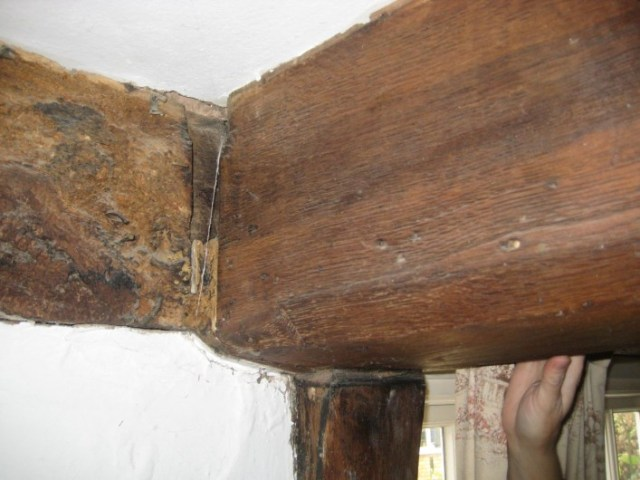 The inserted axial ceiling beam which supported the new first floor in the former open hall