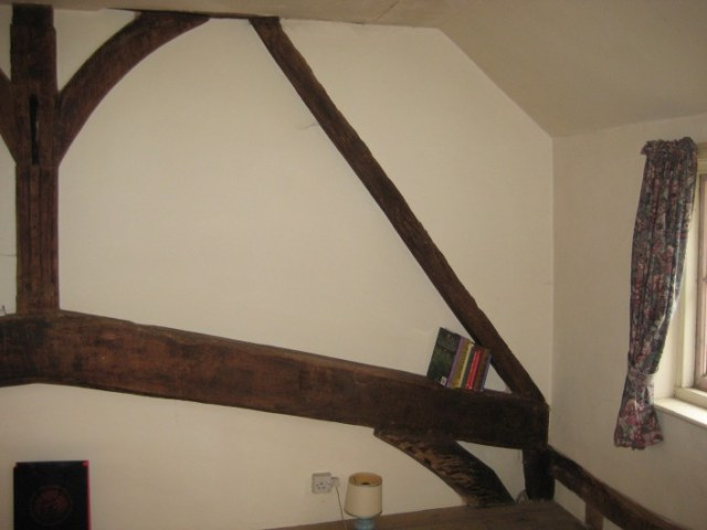 The original eaves level can be clearly seen as well as the original roof profile which was much steeper than now. This would have considerably increased the head height in this room which would have been very low except at the centre.