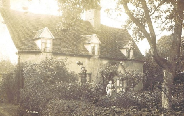 A photo of the house given to the group by Joyce James. We do not know who the lady is, although it could be Annis Baines who lived in the house in 1911.