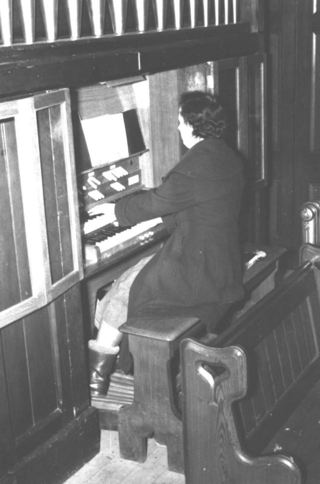 Vera playing the organ at the Methodist church. She has played this organ for 80 years