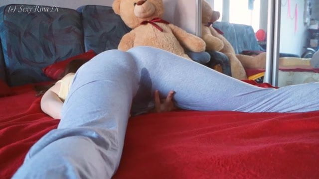 Lazy girl in leggings wets the bed