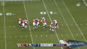 Siemian (far right) unsuccessfully scrambles (courtesy NBC Network)