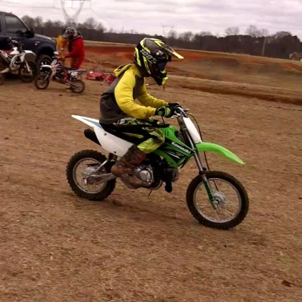 Chris practicing shifting on a friend's dirt bike.