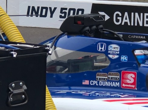 Chip Ganassi Racing's Tony Kanaan sits in the No. 48 American Legion Honda looking at data during Carb Day at the Indianapolis Motor Speedway.