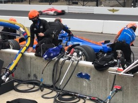 The 'Wolfpack' crew of the No. 9 PNC Bank Grow Up Great Honda of driver Scott Dixon make adjustments on Carb Day
