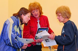 "Adult Services Librarian Karen Shalt demonstrates the ""Hoopla"" app to Marcia Kline and Ginny Zajac. Photo by Chuck LeClaire"