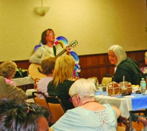 Michelle Muth of M3 Music Therapy demonstrates how music can relieve stress.