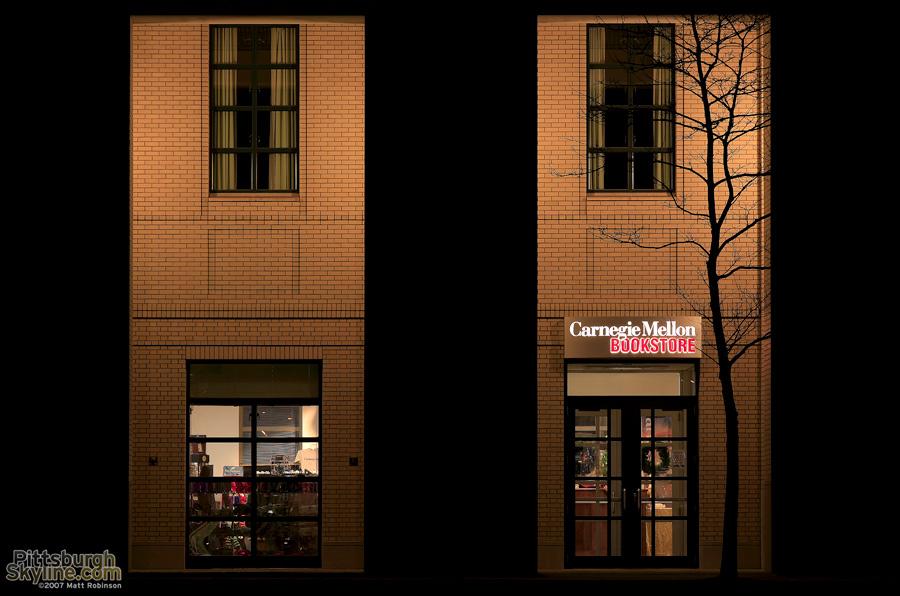 Tree silhouettes the CMU Bookstore