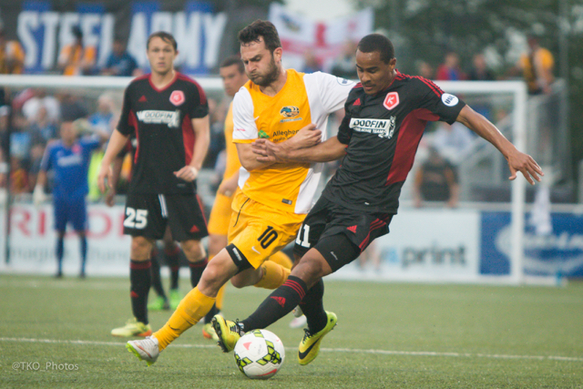 Hounds midfielder Kevin Kerr battles for possession with Richmond's George Davis IV during last weekend's tie at Highmark Stadium (Photo: Terry O'Neil / Riverhounds.com)