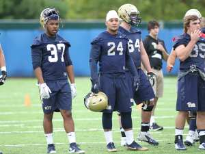 Connor James and Qadree Ollison watch during the first day of practice (Photo by: David Hague)