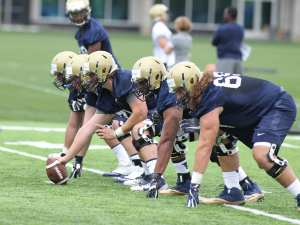 Offensive lineman running snap drills during the first practice of the season (Photo Credit: David Hague)