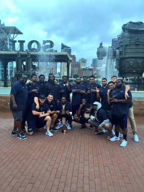The D-line and defensive line coach Coach Tom Sims at Station Square