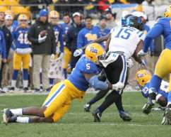 Ejuan Price with the tackle on Quay Mann (Photo by: David Hague)